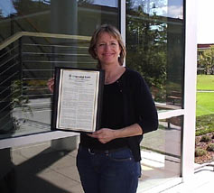 (Photo - Martha Siegel with Congressional record)