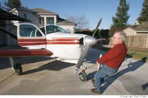 (Photo - Burl Skaggs with his airplane)