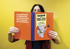 (Photo - woman with BaBar storybook)