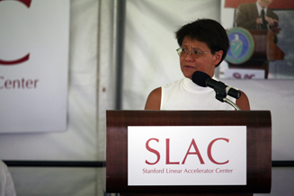 (Photo - Andrea Chan speaks on the SLAC Green during 'Let's Celebrate Jonathan')