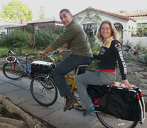 (Photo - Anna Cummins and Marcus Eriksen on a tandem bicycle)