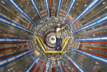 (Photo - man working on the ATLAS detector)