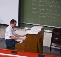 (Photo - Kyle Knoepfel plays the piano in Panofsky Auditorium)
