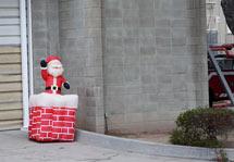 (Photo - blow-up Santa Claus)