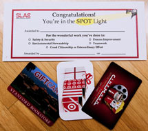 (Photo - Spot Award certificate and gift cards)